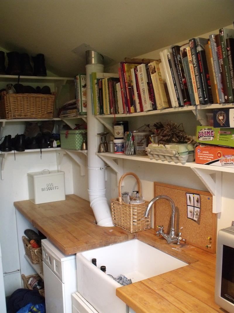 Utility room shelving around belfast sink and worktop